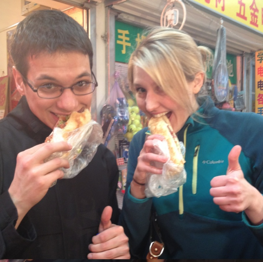 Jalai and friend eating hee-haw in china