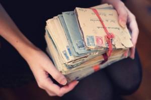 Girl holding envelopes