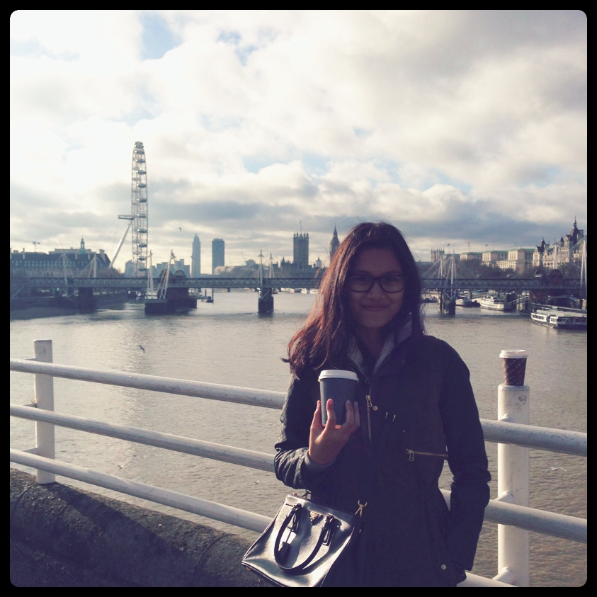 Iffah: My life in London vs Singapore. Me by the Thames river looking out across the London Eye