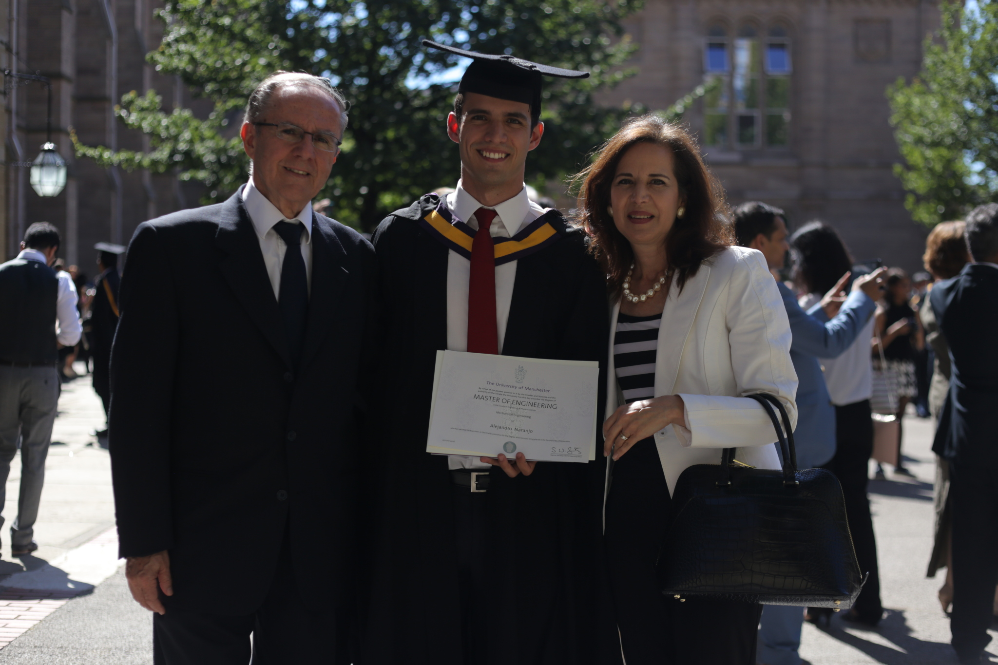 Alejandro Naranjo with his proud parents graduating from Manchester