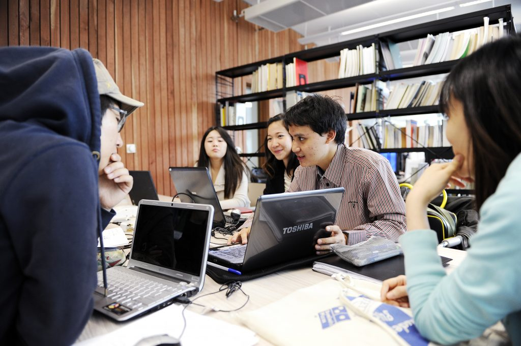 students social studying in a library to get good grades