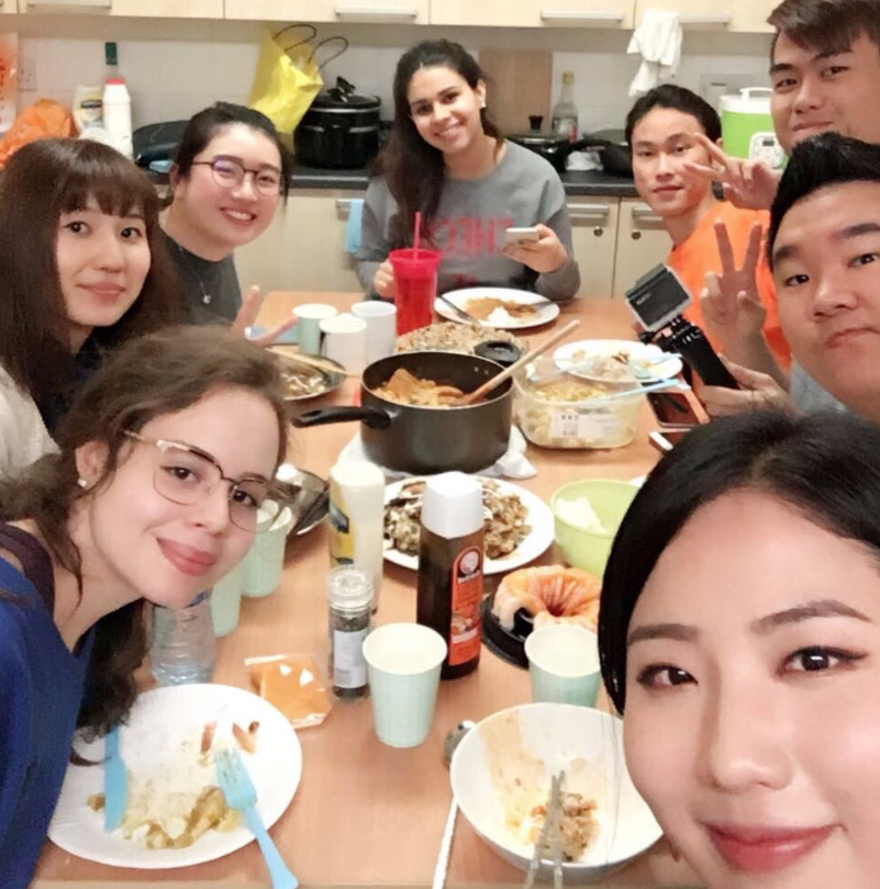 Cooking is a great way to make new friends at university. INTO University of Gloucestershire student Taís (bottom left) from Brazil sharing a meal with her #INTOfriends.