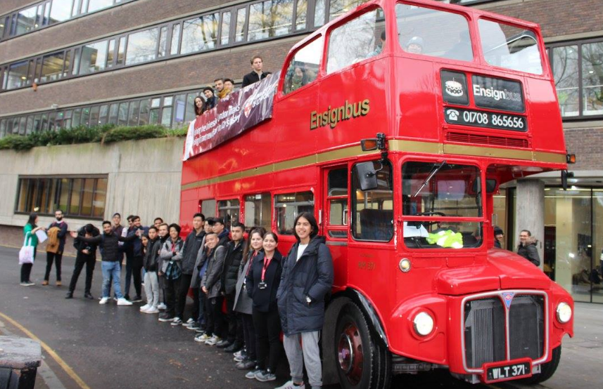 Students explore London on a red open top bus