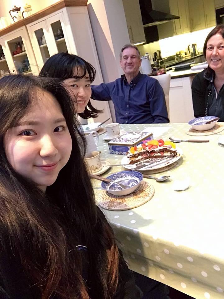 Sayaka_with_host_family_and_friend_university_accommodation_students_UOG