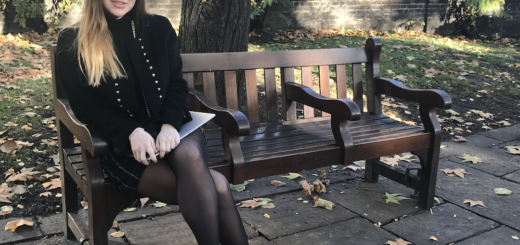 INTO Alumni and UK graduate, Iana, sitting on a bench