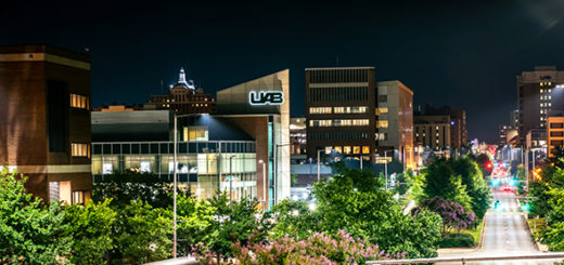 An overlook of the UAB campus lit up in the evening